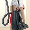 The Miele Classic C1 Titan canister vacuum features an ergnomonic carrying handle for easy transport